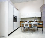 Luxurious kitchen in showroom. Wide-angle view of luxurious kitchen in showroom Stock Photos