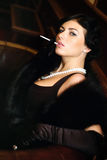 Luxurious lady with a cigarette. Vintage style. Royalty Free Stock Images