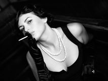 Luxurious lady with a cigarette. Vintage style. Royalty Free Stock Photography