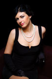 Luxurious lady. Vintage style. Beautiful luxurious woman in black Royalty Free Stock Photos