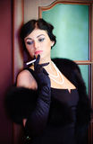 Luxurious lady. Vintage style. Beautiful luxurious woman in black Royalty Free Stock Photography