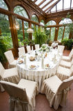 Luxurious laid wedding table. In windowed orangery stock photography
