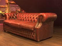 Luxurious leather couch. View of a comfy leather couch, to rest your legs. Venus Club series Royalty Free Stock Photos