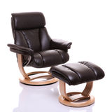 Luxurious leather recliner chair with footstool Royalty Free Stock Photography