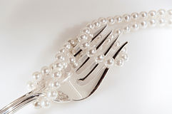 Luxurious lifestyle. Stilll life with silver fork and pearls Stock Images