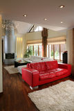 Luxurious living room. Interior details of luxurious living room with red sofa royalty free stock image