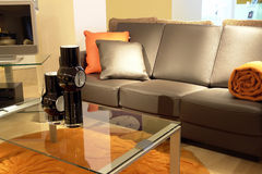 Luxurious living room. Cosy settee and glass table in luxurious living room Stock Photography