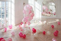 Luxurious living room with large window to the floor. Palace is filled with pink balloons. nobody. Luxurious living room with large window to the floor. The Royalty Free Stock Photography