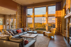 Luxurious Living Room in New Home with Sunset View Stock Images