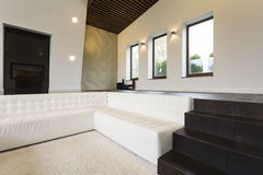 Luxurious living room with sofa. And the fireplace royalty free stock images