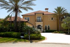 Luxurious mansion. Exterior of luxurious mansion with palm trees in foreground, Florida, U.S.A stock photography