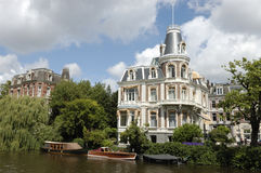 Luxurious mansion on Amsterdam canal. Royalty Free Stock Image
