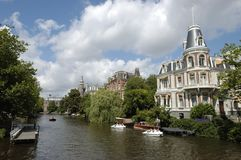 Luxurious mansion on Amsterdam canal. Royalty Free Stock Images