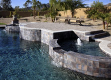 Luxurious mansion pool, spa and patio Royalty Free Stock Photography