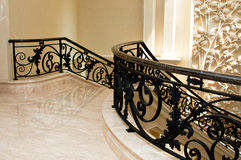Luxurious Marble Stairway. A marble flooring stairway with wrought iron and marble railing Stock Images