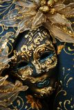 Luxurious mask. A luxurious blue venetian mask with gold details royalty free stock images
