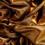 Luxurious metallic gold fabric Stock Photography