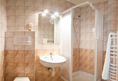 Luxurious modern bathroom. Interior of luxurious modern bathroom with shower cubicle and sink stock photos