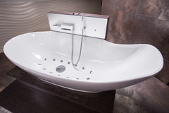 Luxurious modern bathtub Stock Images