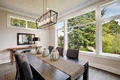 Luxurious modern dining room boasts a black dining table Stock Photography