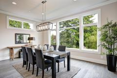 Luxurious modern dining room boasts a black dining table Royalty Free Stock Photos