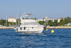Luxurious modern private yacht at the pier on mediterranean sea Stock Photo