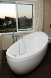Luxurious and Modern White Bathtub - Window View Stock Photography