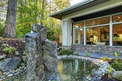 Luxurious new construction home exterior with pond Royalty Free Stock Photography