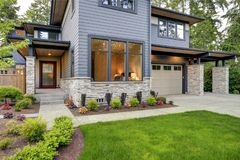 Luxurious home design with modern curb appeal in Bellevue. Luxurious new home with curb appeal. Trendy grey two-story exterior in Bellevue with large picture Royalty Free Stock Photo