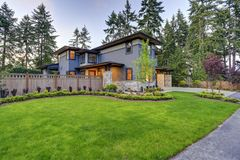 Luxurious home design with modern curb appeal in Bellevue. Luxurious new home with curb appeal. Trendy grey two-story mixed siding exterior in Bellevue with Stock Images