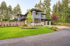 Luxurious home design with modern curb appeal in Bellevue. Luxurious new home with curb appeal. Trendy grey two-story mixed siding exterior in Bellevue with Royalty Free Stock Photos
