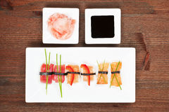 Luxurious nigiri sushi. Delicious nigiri sushi on white plate. Ginger and soy sauce in white bowl Royalty Free Stock Photography