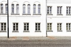 Luxurious old apartament house with a white facade. And some windows Royalty Free Stock Photos