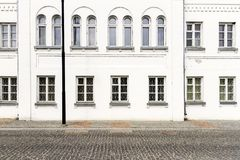 Luxurious old apartament house with a white facade. And some windows Stock Photography