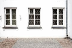 Luxurious old apartament house with a white facade. And three windows stock image