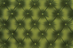 Luxurious olive green-tone leather texture. Furniture with buttons, chesterfield pattern Royalty Free Stock Photography