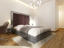 Luxurious one double bed in the hotel room in art Deco. Stock Images