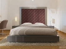 Luxurious one double bed in the hotel room in art Deco. A large padded headboard and bedside tables with table lamps. 3D render Royalty Free Stock Images