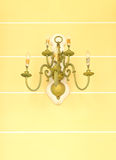 Luxurious ornate gold wall chandelier Stock Photos