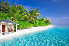 Luxurious over-water bungalows in beautiful lagoon on tropical island Stock Photo