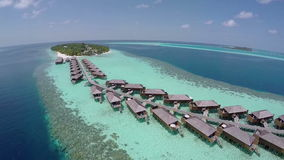Luxurious over-water villas on tropical island resort stock video footage