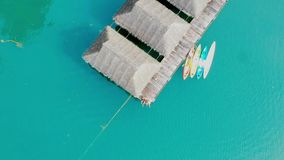 Luxurious over-water villas on tropical island resort. Aerial footage. stock video footage