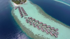 Luxurious over-water villas on tropical island resort, Maldives. stock video footage