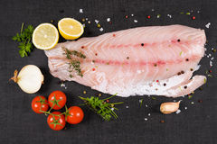 Luxurious perch fillet. Luxurious perch fillet on black background, top view. Culinary fish eating stock images