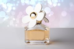 Luxurious perfume in beautiful bottle with white flowers as perf stock photography