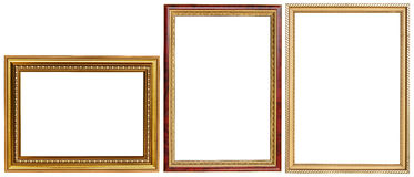 Luxurious picture frame set. A set of luxurious golden picture frames isolated on white background royalty free stock photo