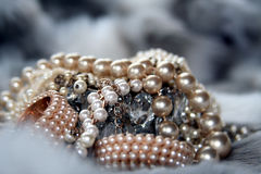 Luxurious pile of pearl jewelry. On fur stock photography