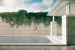 Luxurious pool with patio sideview Royalty Free Stock Photo