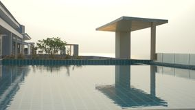 A luxurious pool on the roof of the house with a sea view. On the Sunset. 4k, slow motion, solar glare on the water. Background blur stock footage