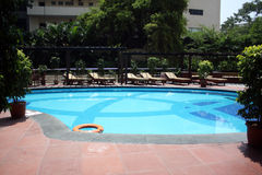 Luxurious Poolside Royalty Free Stock Images